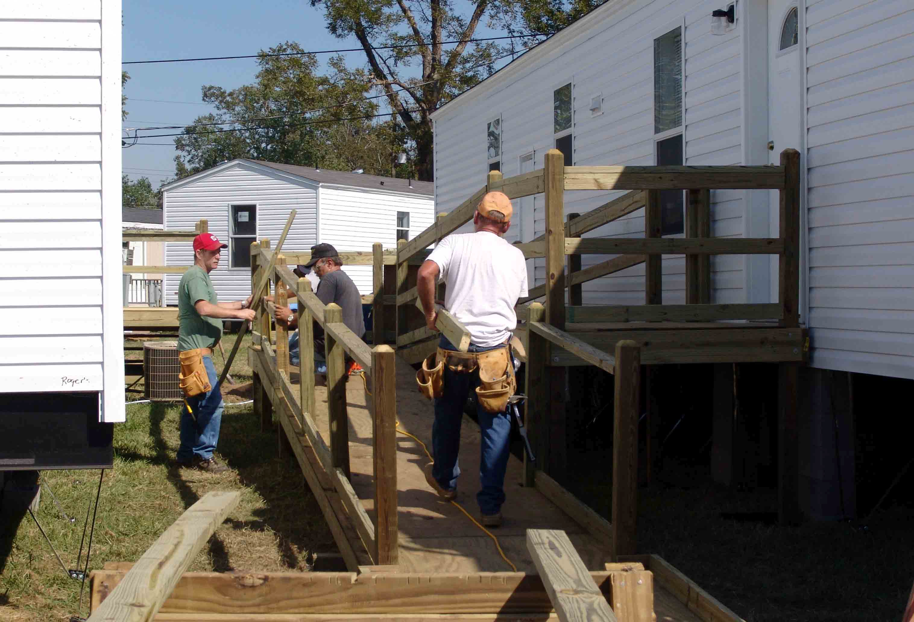 Workers Build A Ramp To Create A Wheelchair Accessible
